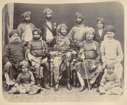 [Group portrait with the Nawab of Junagadh and state officials.]